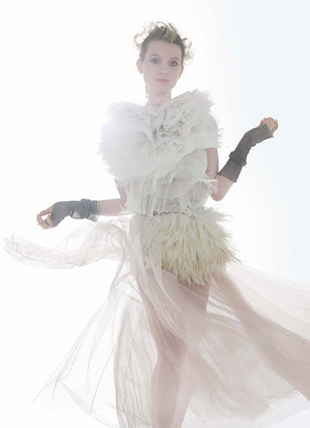 Mia Wasikowska in Nina Ricci silk tulle and ostrich feather top and Chloé tulle skirt.