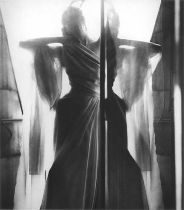 "Lillian Bassman: ""Paris: Dinner at Nine,"" model Barbara Mullen, dress by Piguet, Paris, 1949 (Harper's Bazaar, 1949)."